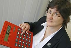 Woman holding a calculator