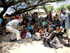 Max Lucado entertains a group of Ethiopian chi...