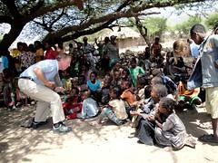 Max Lucado entertains a group of Ethiopian chi...