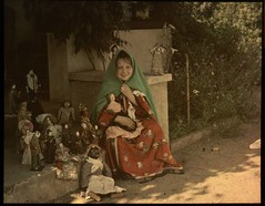 Girl with collection of dolls