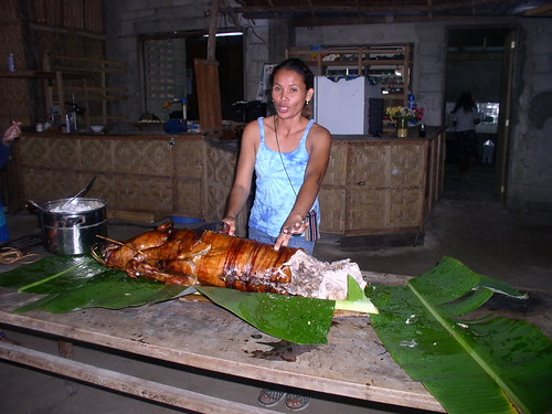 Siargao Island, Surigao del Norte woman carving lechon  Buhay Pinoy Philippines Filipino Pilipino  people pictures photos life Philippinen