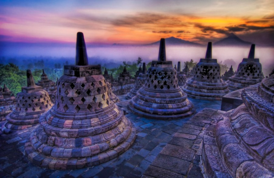 The caged Buddhas look outward towards the sunrise