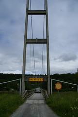 Car passing the narrow bridge