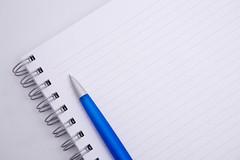 aspiral notebook and pen