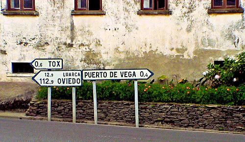 Road Signs at intersection in Santa Marina, Spain