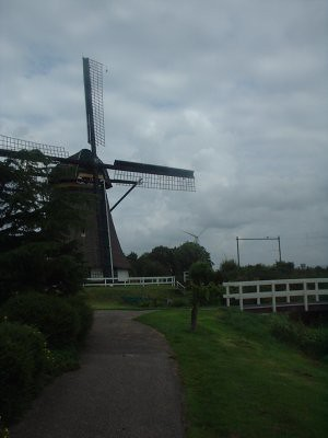if you look in the background you can see a modern day equivalent to this 200+ year old windmill.. the wind turbine.