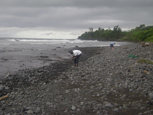 Mathew (right) and his cousin collect stones on a Limbe beach