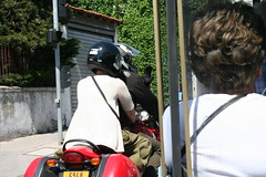 Motorcyclist waves to tourists