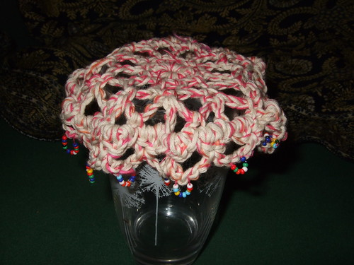 crocheted cover on glass