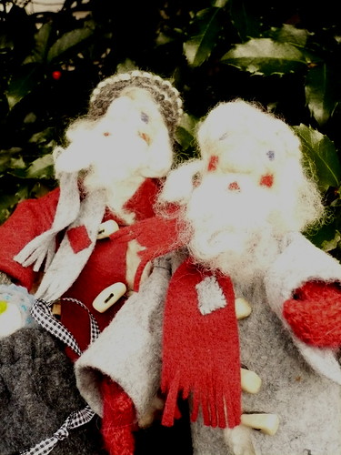 Santas in their coats and mufflers