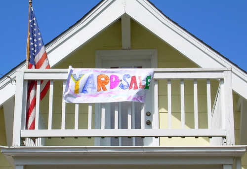 Yard sale sign on balcony