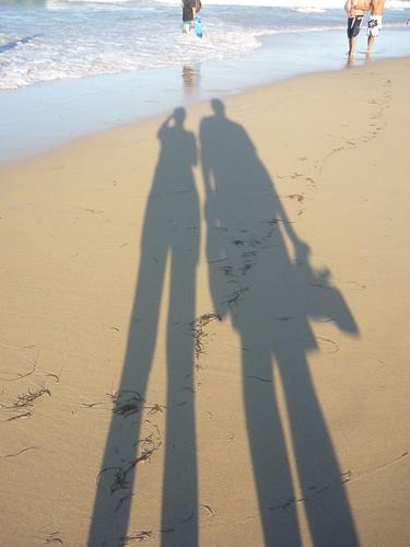 Our long shadows on the beach