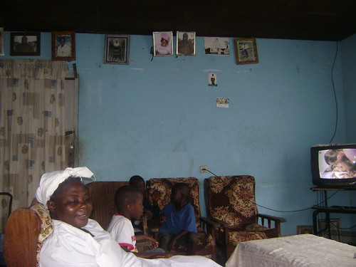 Beas family parlour. Decor in Cameroon requires hanging family photos up near the ceiling, even if theres nothing else on the wall.