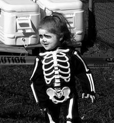 A kid wearing a skeleton costume
