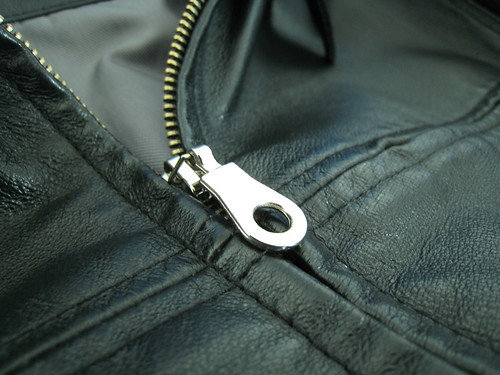 The replacement zipper, ugly but... it works.