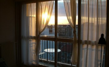 Big window in my apartment at sunset.