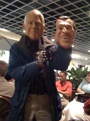 John McCain holding Bush's head.
