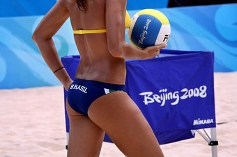 Brasil volleyball player in a  biki, shot from behind, decapitated