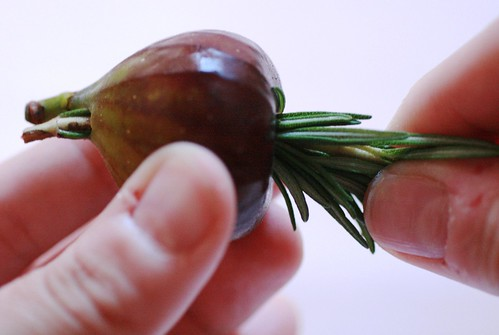 Threading fig onto rosemary sprig