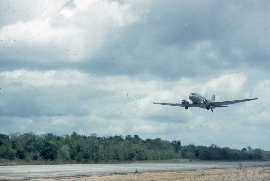 Dakota over Mackenzie airfield, MacKenzie, British Guiana