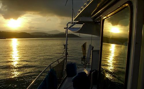 Sunset skipping off a sailboat window, Near Ko Samui, Thailand