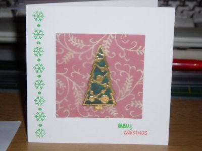 the christmas tree in the middle of this card was made with a stamp