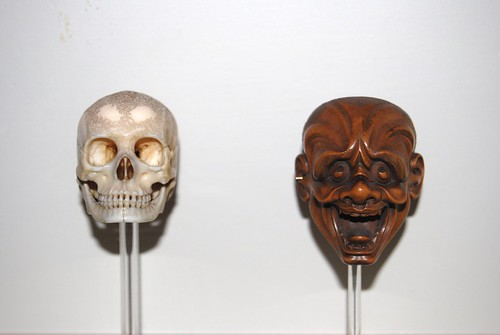Skull and mask netsuke