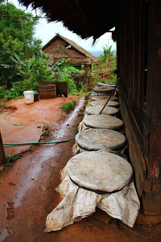 Making Laotian whisky, Phonsavan