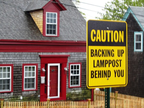 Caution Backing Up Lamppost