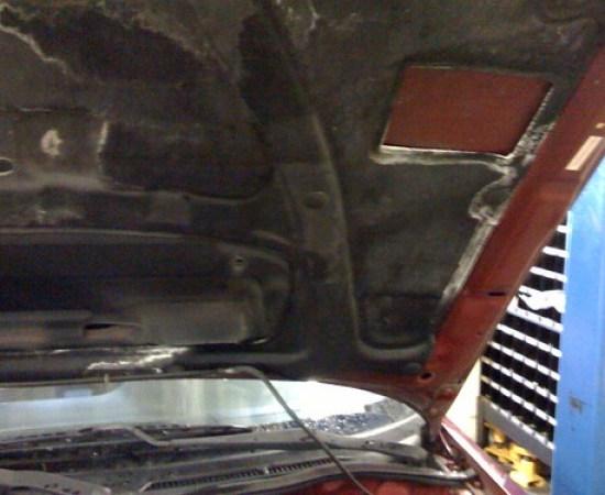 Battery Acid On The Hood Liner of a Subaru