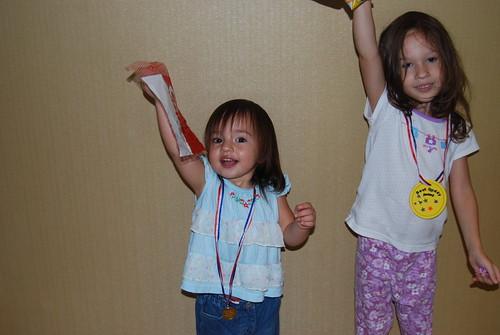 The girls salute Singapore Ntl. day