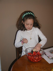 Lydia mashing the strawberries