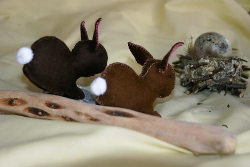 Two Felt Rabbits Hopping Away