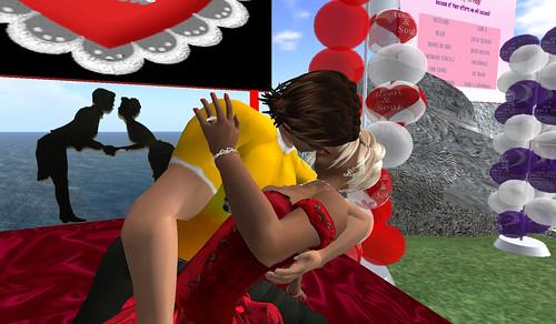 Rav plants a kiss on Amanda at the kissing booth