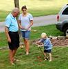 Papa, Marygrace & Joey playing croquet