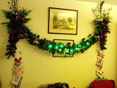 Two candle sconces are permanently affixed to the living room wall - every year i decorate them for christmas. This is this years effort.
