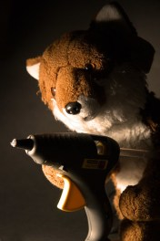 Fox holding gun