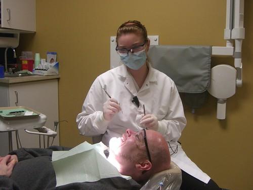 Allison cleaning my teeth