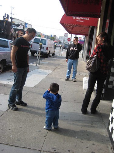 we started off by going to Irving Street to pick up some Dim Sum to go.  Here you see Daddy talking to mommy on the phone and Emmett pretending to do the same.