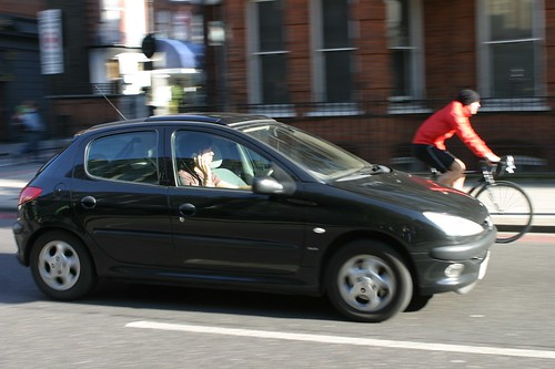 Driver passing a cyclist on the nearside