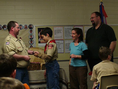 Forest receiving his First Class Scout rank.