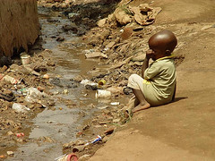 Child in slum in Kampala (Uganda) next to open...
