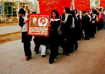 Demonstration in support of the PDPA. Photo held by marchers is of Nur Muhammad Taraki, first president of Afghanistan after the Saur Revolution.