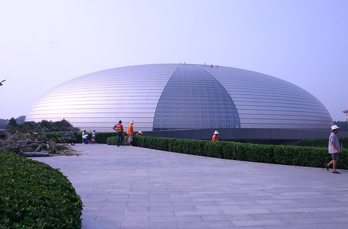 Workers maintain the grounds and clean the exterior of the National Center for the Performing Arts in preparatin for the July 24 concert