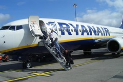 Passengers leaving Ryanair jet