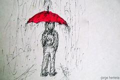 paragua rojo en dia gris