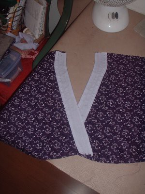 top two portions of the front part done, with collars attached..