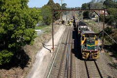 4703/4498 head up a spoil train at Mt Colah