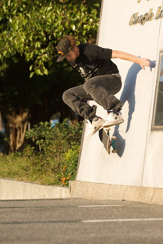 John with a kickflip wall ride.
