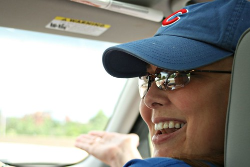 Heather, commenting on the crazy drivers.  I love how you can see Cindy in the reflection of her glasses.